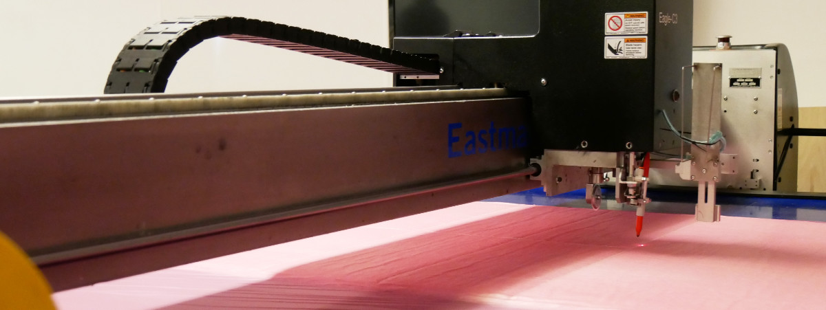 Pink-film-covered-glass-fabric-on-machine